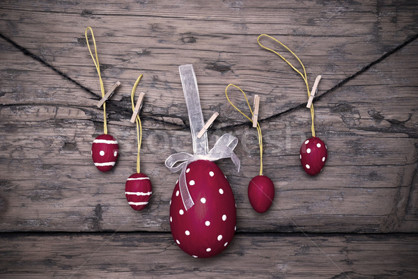 Many Red Easter Eggs And One Big Egg Hanging On Line Frame Stock photo © Nelosa