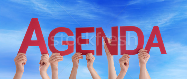 Hands Holding Red Straight Word Agenda Blue Sky Stock photo © Nelosa
