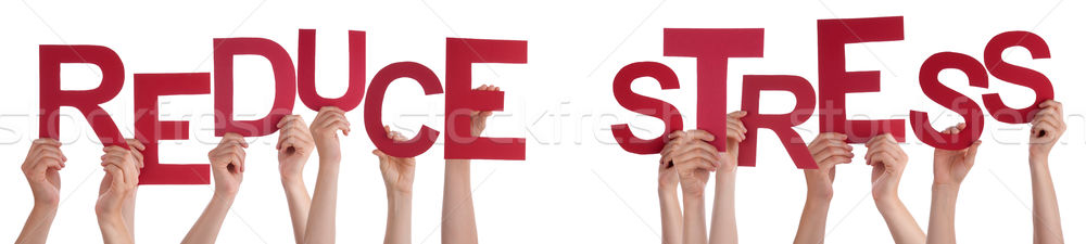 People Hands Holding Red Word Reduce Stress Stock photo © Nelosa