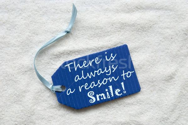 állandóan mosoly kék címke homok egy Stock fotó © Nelosa