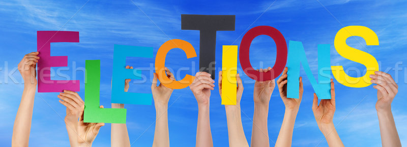Hands Holding Colorful Word Elections Blue Sky Stock photo © Nelosa