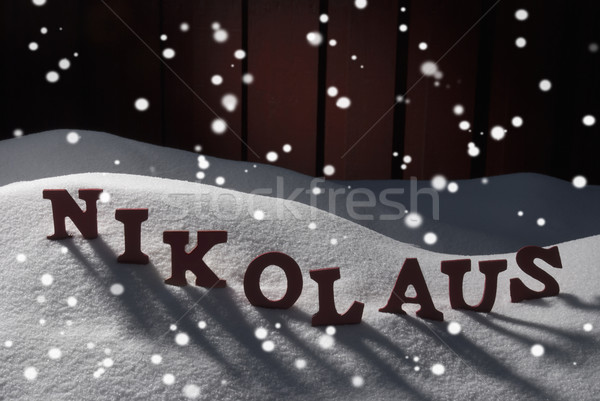 Nikolaus Means Santa Claus On Snow And Snowflakes Stock photo © Nelosa