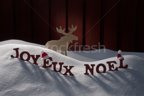 Joyeux Noel Means Merry Christmas On Snow Moose Stock photo © Nelosa