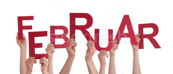 People Holding German Word Februar Means February Stock photo © Nelosa