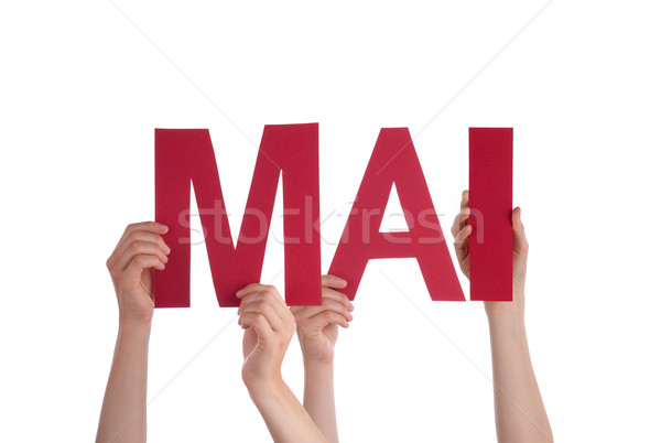People Holding Straight German Word Mai Means May Stock photo © Nelosa