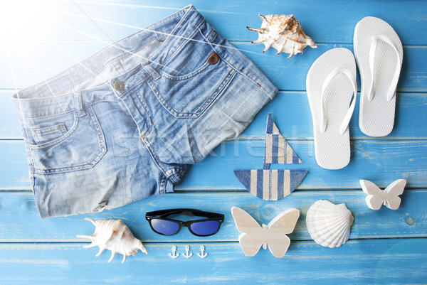 Sunny Summer Clothes And Decoration On Wooden Background Stock photo © Nelosa