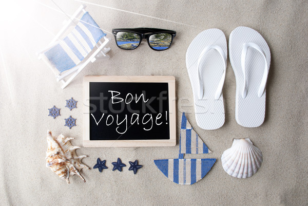 Sunny Blackboard On Sand, Bon Voyage Means Good Trip Stock photo © Nelosa