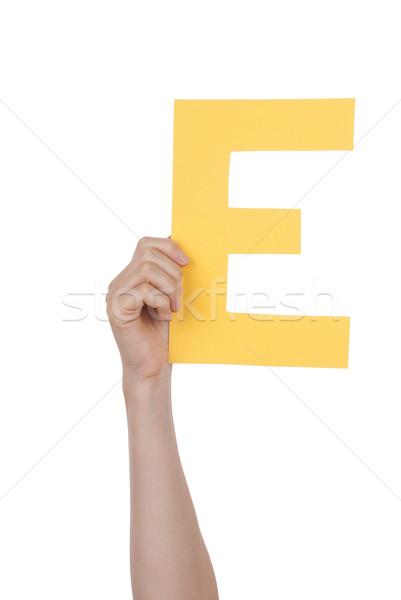 Hand Holding Yellow E Stock photo © Nelosa