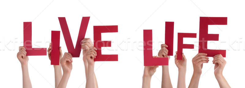 People Hands Holding Red Word Live Life Stock photo © Nelosa