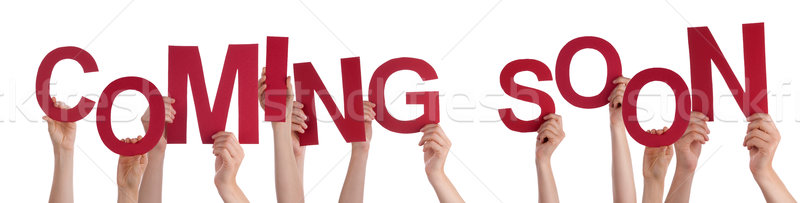 People Hands Holding Red Word Coming Soon Stock photo © Nelosa