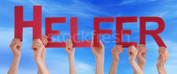 Ludzi utrzymać prosto pomocnik Błękitne niebo wiele Zdjęcia stock © Nelosa