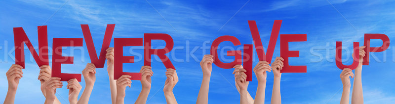 People Hands Holding Red Word Never Give Up Blue Sky Stock photo © Nelosa