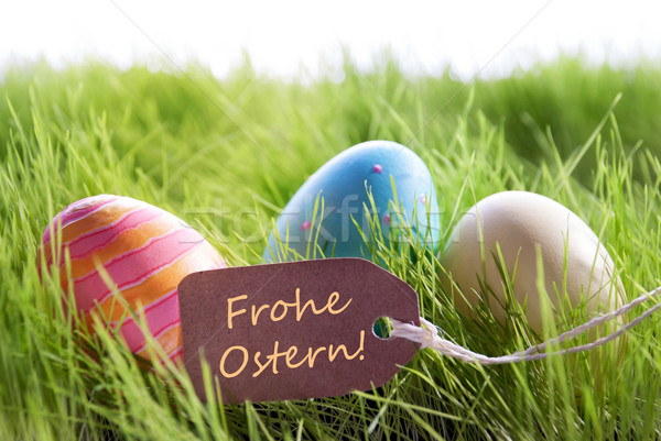 Happy Easter Background With Colorful Eggs And Label With German Text Frohe Ostern Stock photo © Nelosa