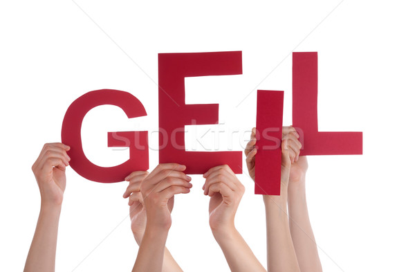 People Holding  German Word Geil Means Cool Stock photo © Nelosa