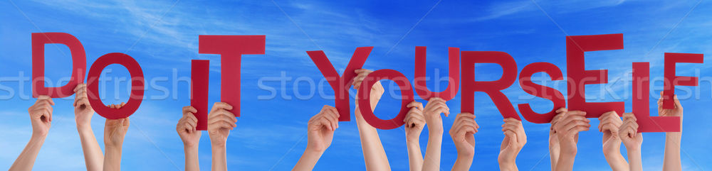 People Hands Holding Red Word Do It Yourself Blue Sky Stock photo © Nelosa
