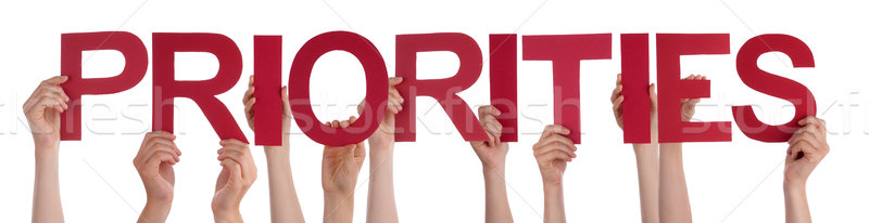 Many People Hands Holding Red Straight Word Priorities Stock photo © Nelosa
