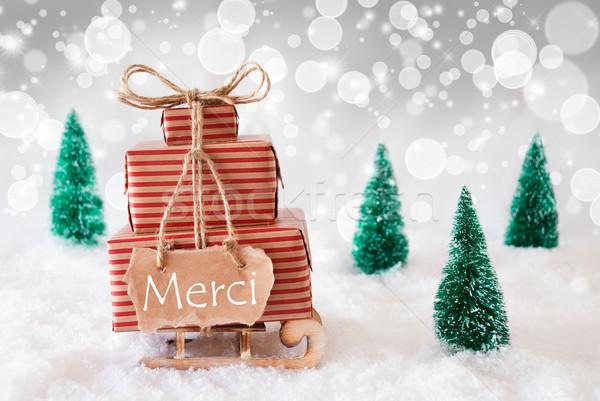 Christmas Sleigh On White Background, Merci Means Thank You Stock photo © Nelosa