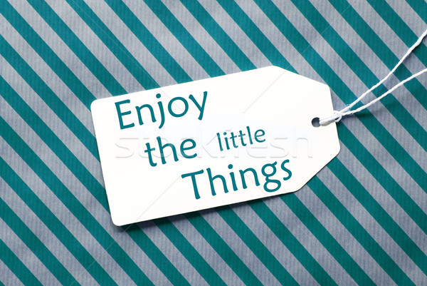 Label On Turquoise Wrapping Paper, Quote Enjoy The Little Things Stock photo © Nelosa
