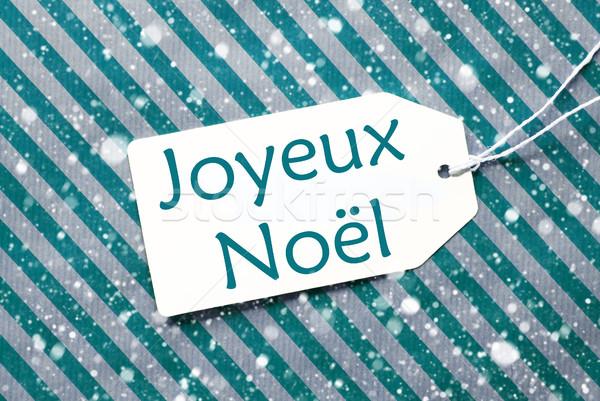Label On Turquoise Paper, Snowflakes, Joyeux Noel Means Merry Christmas Stock photo © Nelosa