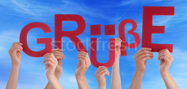 People Holding German Word Gruesse Means Regards Blue Sky Stock photo © Nelosa