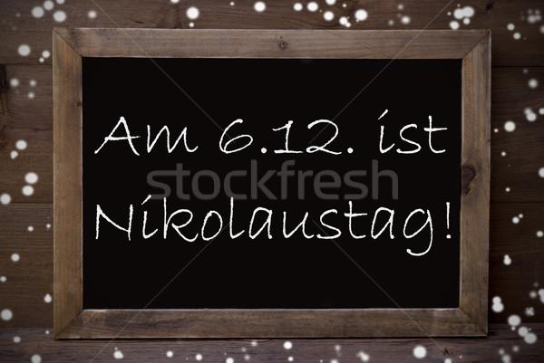 Chalkboard With Nikolaustag Means Nicholas Day, Snowflakes Stock photo © Nelosa