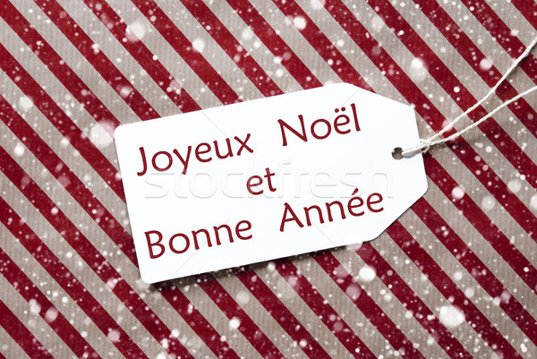 Label On Red Paper, Snowflakes, Bonne Annee Means New Year Stock photo © Nelosa