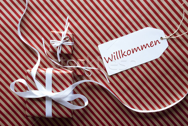 Two Gifts With Label, Willkommen Means Welcome Stock photo © Nelosa