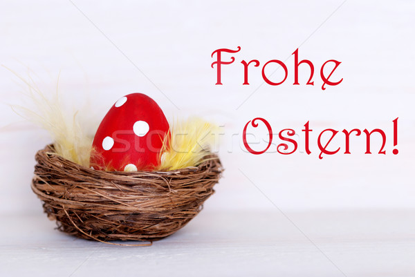 One Red Easter Egg In Nest With German Frohe Ostern Means Happy Easter Stock photo © Nelosa