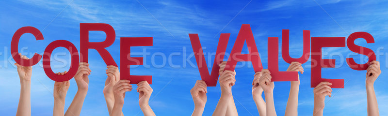 People Hands Holding Red Word Core Values Blue Sky Stock photo © Nelosa