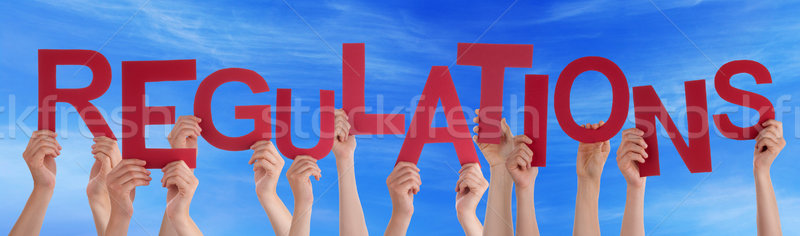 People Hands Holding Red Word Regulations Blue Sky Stock photo © Nelosa