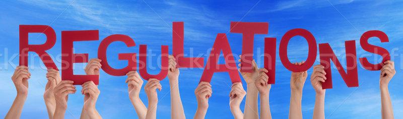 Emberek kezek tart piros szó kék ég Stock fotó © Nelosa