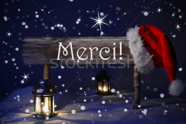 Christmas Sign Candlelight Santa Hat Merci Means Thank You Stock photo © Nelosa