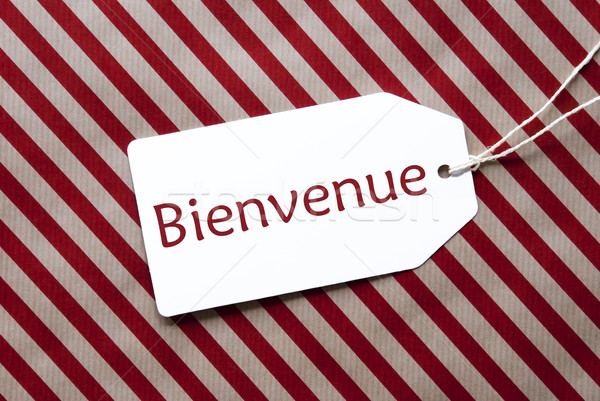 Label On Red Wrapping Paper, Bienvenue Means Welcome Stock photo © Nelosa