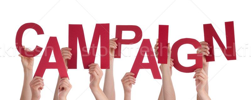 Sok emberek kezek tart piros szó Stock fotó © Nelosa