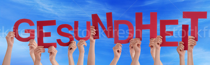 People Holding German Word Gesundheit Means Health Blue Sky Stock photo © Nelosa