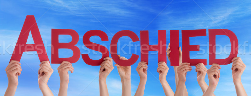 People Holding Straight German Word Abschied Means Goodbye Blue  Stock photo © Nelosa