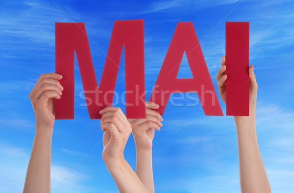 People Holding Straight Word Mai Mean May Blue Sky Stock photo © Nelosa