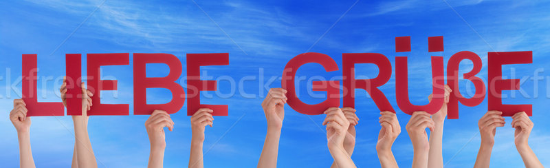 People Hold Straight Word Gruesse Means Love Sky Stock photo © Nelosa