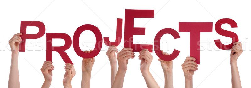 Beaucoup personnes mains rouge mot Photo stock © Nelosa