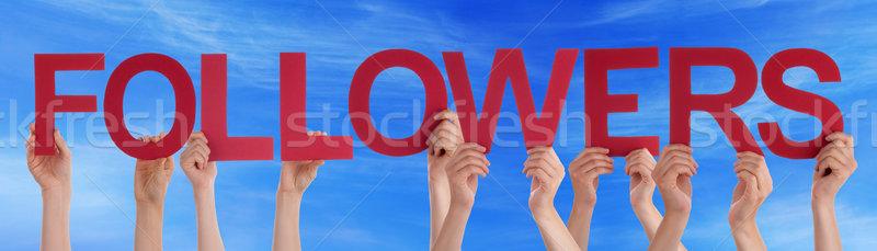 Eller kırmızı düz kelime mavi gökyüzü Stok fotoğraf © Nelosa