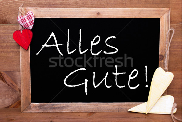 One Chalkbord, Red And Yellow Hearts, Alles Gute Means Congratulations Stock photo © Nelosa