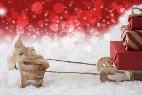 Reindeer With Sled, Christmassy Bokeh And Stars Background, Copy Space Stock photo © Nelosa