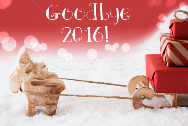 Reindeer With Sled, Red Background, Text Goodbye 2016 Stock photo © Nelosa