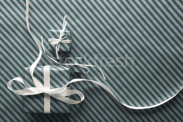 Two Gifts With White Ribbon On Light Green Wrapping Paper Stock photo © Nelosa