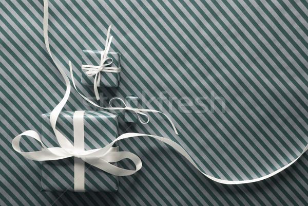 Kettő ajándékok fehér szalag világoszöld csomagolópapír Stock fotó © Nelosa