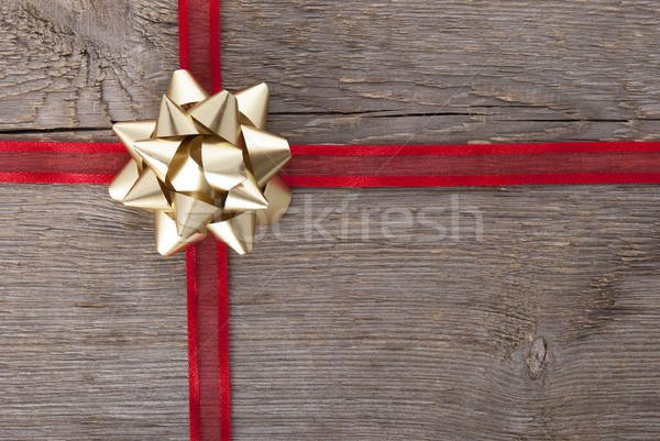 red ribbon with golden bow Stock photo © Nelosa
