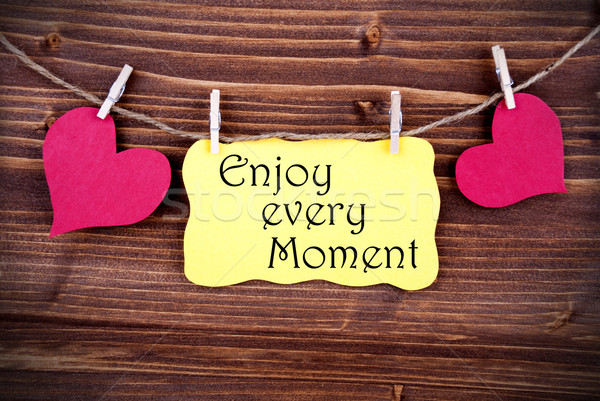 Yellow Lable Saying Enjoy Every Moment Stock photo © Nelosa