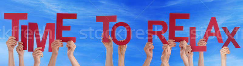 People Hands Hold Red Word Time To Relax Blue Sky Stock photo © Nelosa