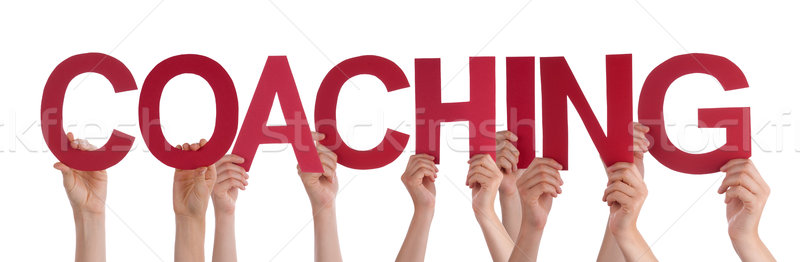 Hands Holding Red Word Coaching Stock photo © Nelosa