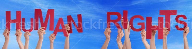 Mensen handen Rood woord mensenrechten Stockfoto © Nelosa